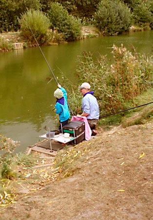 Mike Dixon helps Casey on the Beavers Angling Badge event